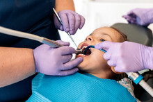 Young Girl During Checkup In Dentist