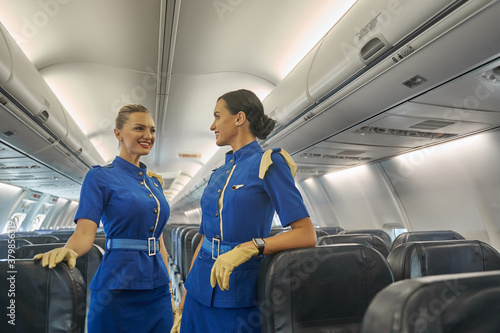 Fotomural Two female cabin crew members waiting for the passengers