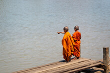Young Monks On A Wooden Boat Pier At Inle Lake In Burma, Myanmar