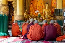 Group Of Monks Praying At Shwe...