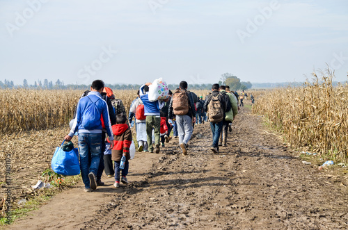 Photo Group of War Refugees walking in cornfield