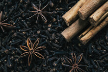Christmas Spices, Cinnamon And Star Anise On A Bed Of Cloves