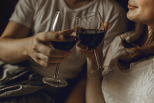 Man And Woman Clanging Wine Gl...