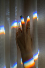 Hand In The Shape Of A Peace Sign With A Light Prism On It