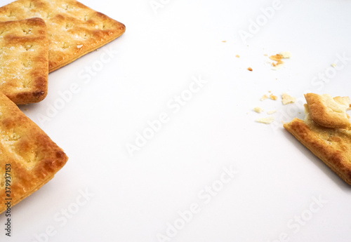 Fototapeta Square crackers or biscuits and cracked biscuits on the white background