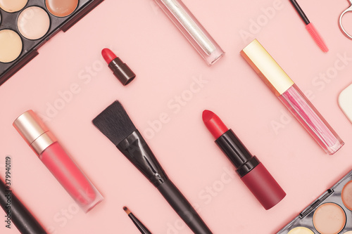 set of professional cosmetics, makeup tools and accessories on pink background, beauty, fashion, shopping concept, flat lay