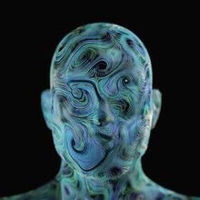 Human Face Composed Of Blue And Green Swirls