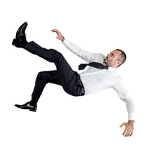 Businessman Falling Down Isola...