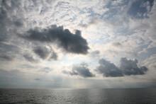 Black Clouds Coming Down At Sea