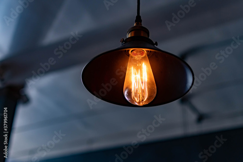 Cuadros en Lienzo Vintage hanging lamp with light bulb over blurry background