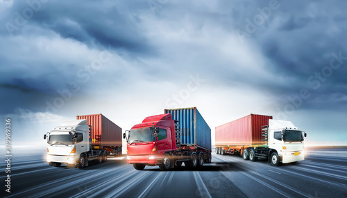 Fototapeta Truck transport with red container on highway road at sunset, motion blur effect, logistics import export background and cargo transport industry concept obraz