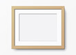 Horizontal wooden frame with passepartout hanging on a white wall. Blank elegant frame template. Picture frame vector mockup.