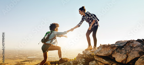 Helping each other to the top of mountain Canvas Print
