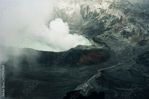 Crater Lake with smoke in Poas Volcano National Park Wallpaper Mural