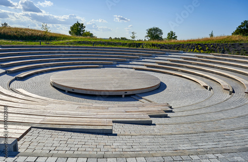 Small ancient roman amphitheatre in the park Wallpaper Mural