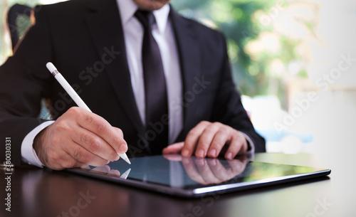 Fototapeta Businessman Signing Digital Contract On Tablet Using Stylus Pen obraz