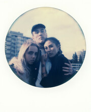 Polaroid Print Of Three Friends Hugging On A Rooftop In London