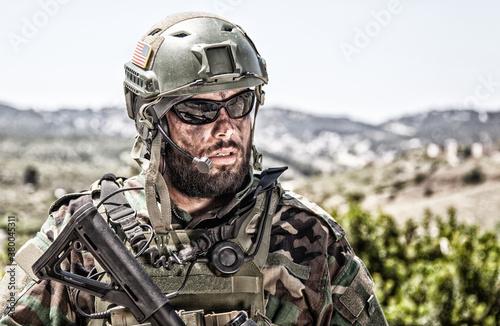 Fotomural Shoulder portrait of army soldier, special forces fighter, modern warfare combat