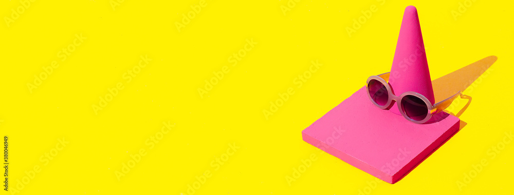 Fototapeta Minimal scene in isometric fashion abstract geometry objects and stylish accessory sunglasses in pink yellow colours. Shopping and sale concept