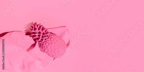 Minimal scene fashion pink pineapple and fabric. Pastel Pink  vanilla colours. Copy space