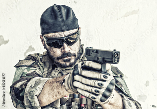 Army soldier, special forces fighter in camouflage uniform, ballistic glasses an Wallpaper Mural
