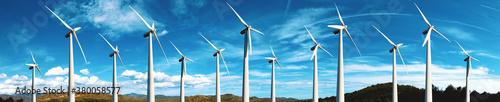 Fototapeta Renewable energy and wind turbines. Wind mills farm and sunset landscape. obraz