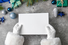Santa Claus With Blank Paper S...