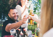Cinco: Woman Hands Beer Across Table To Friend