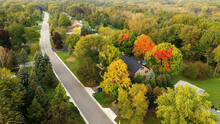 Aerial Drone View Of American Suburban Neighborhood. Establishing Shot Of America's  Suburb. Residential Single Family Houses Pattern. Autumn Fall Season