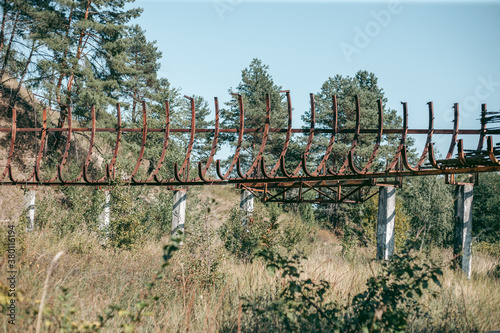 Old abandoned wooden bobsleigh track in summer by daylight Fototapete