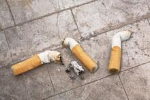Cigarette Butts On The Desk. B...