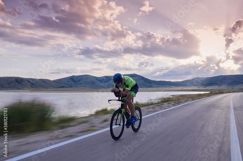Obraz na plátně triathlon athlete riding bike