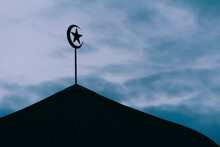 Mosque Dome With Islam Symbol Silhouette At Sunset