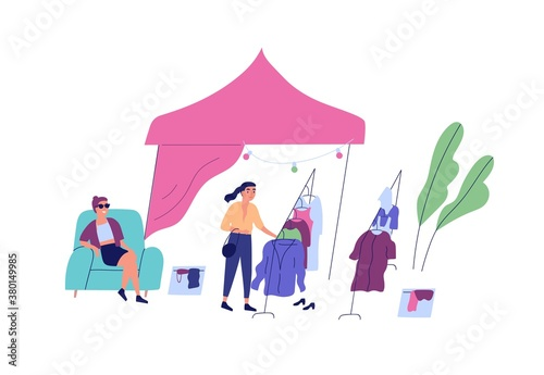 Fototapeta Female choosing clothes at rag fair or street market vector flat illustration. Buyer touch apparel on hanger, seller sit on armchair at outdoor shop or boutique isolated. Stall or tent at marketplace obraz