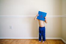 Little Boy Hides Face Behind A Blue Emoticon Building Block Face