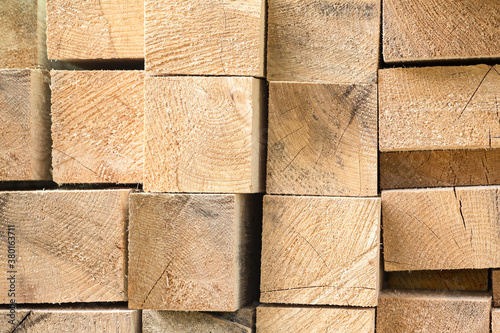 Fényképezés fresh cut stacked building lumber. natural wood texture