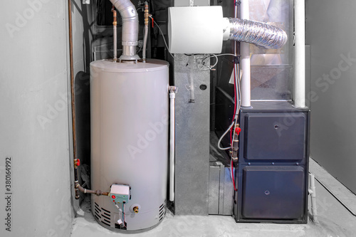 Fototapeta A home high efficiency furnace with a residential gas water heater & humidifier