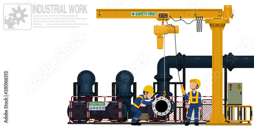 Two workers are operating jib crane for maintenance pump system
