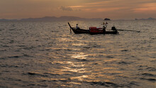 Man Fishing From A Longtail Boat In Thailand