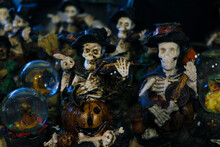 Halloween Decoration. Scary Figurines Of The Dead On The Shelf.