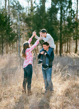 Three Kids Playing And Hiking In A Field And Woods