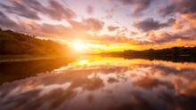 A Sunset Or Sunrise Scene Over...
