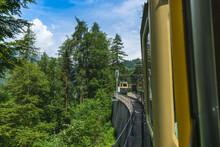 Cog Wheel Train In The Swiss Alps