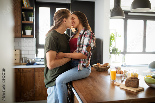 Fototapeta Romantic couple hugging and kissing, having a great time together. obraz