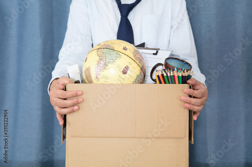 Unemployed young man and a box of personal belongings Canvas Print