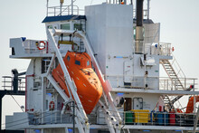 Orange Lifeboat On A Large Ship