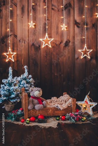 small bed with toy bear little trees and christmas decorations