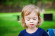 portrait of a cute little girl with closed eyes