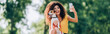 horizontal concept of excited woman taking selfie on mobile phone with jack russell terrier dog