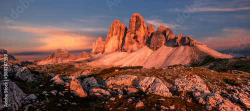 Fantastic mountain landscape at sunset. Majestic Tre cime di lavaredo peaks with colorful sky. Dolomites Alps. Tre Cime di Lavaredo national park. Popular travel and hiking Destination in the world.
